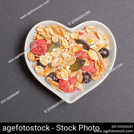 Vital Müsli in einer weißen Schale für die Foodfotografie Vital muesli in a white bowl for food photography