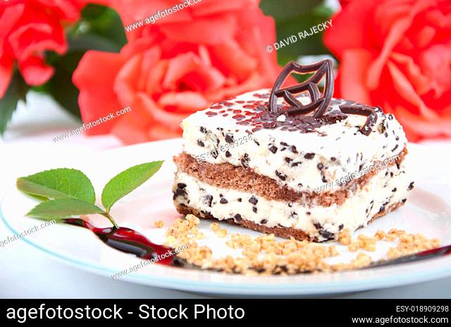 Sweet chocolate dessert with nuts and rose