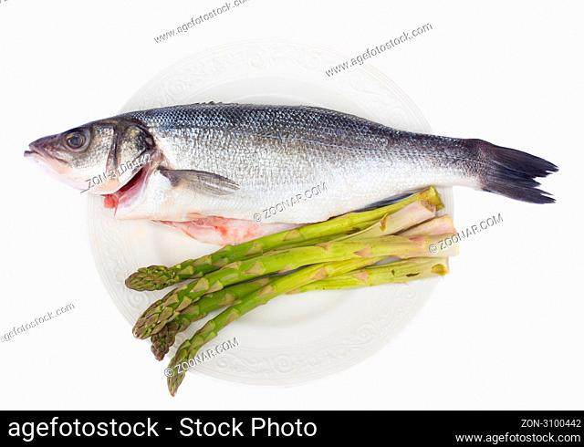 sea bass fish with asparagus on plate isolated on white background