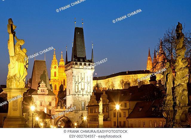 czech republic prague - charles bridge and st  nicolaus church at dusk