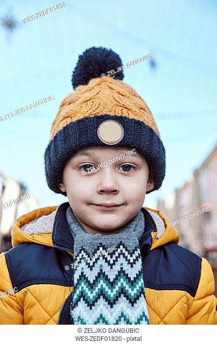 Portrait of a little boy, wearing wooly hat