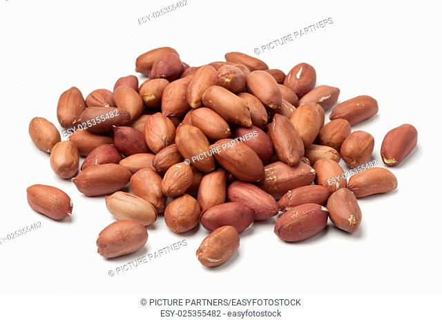 Heap of peeled peanuts on white background