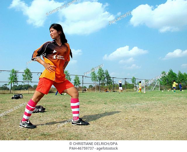 "Members of the women's soccer team """"Mighty Girls"""" Socheata Seng (19, F)warms up during training in Battambang, Cambodia, 13 February 2014"