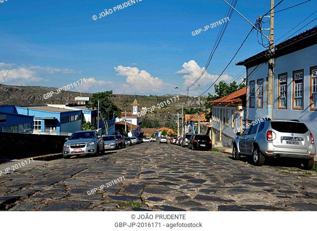 Colonial houses in the street in the historic center of the city left Santa Casa Chapel and Santa Isabel and the background Sierra of Crystals, Diamantina
