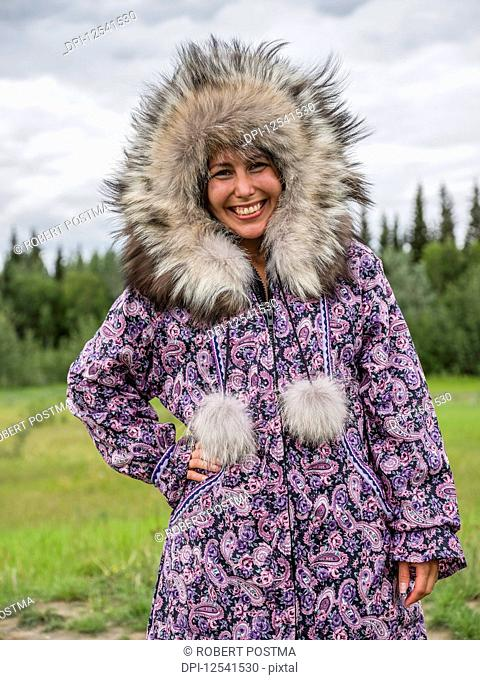 First nation woman dressed in handmade traditional coat; Mayo, Yukon, Canada