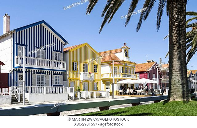Colorful houses of Costa Nova, a seaside resort and suburb of Aveiro. Aveiro in Portugal on the coast of the Atlantic. Because of the many channels Aveiro is...