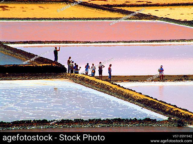Group of tourists visiting the salt works. Salinas de Janubio Nature Reserve, Lanzarote, Canary Islands, Spain