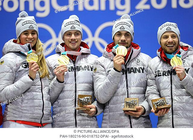 Natalie Geisenberger, (left to right) Johannes ludwig, Tobias Wendl and Tobias Arlt from Germany showing their gold medals during the award ceremony of the team...