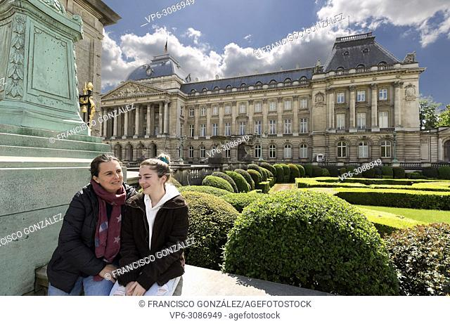 Mother and daughter next to the royal palace with its gardens in Brussels capital of Belgium