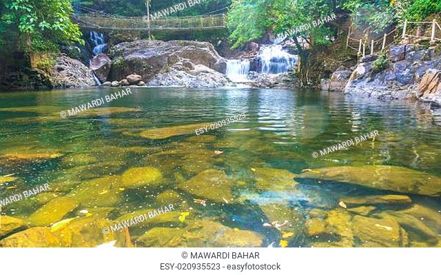Waterfall and clear water early morning in tropical forest