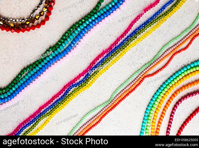 Sets for embroidery and jewelry making with beads on a table, top view