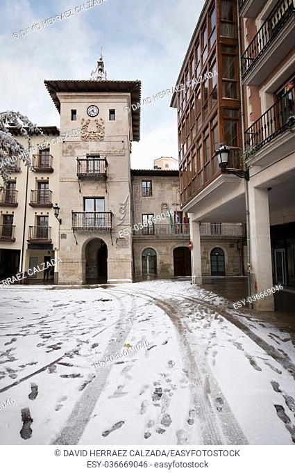 Winter scene of a snowed cityscape landscape of the ancient village of Briviesca in Burgos Province, Castilla y Leon, Spain