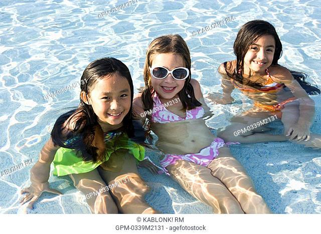 Three young girls in swimming pool