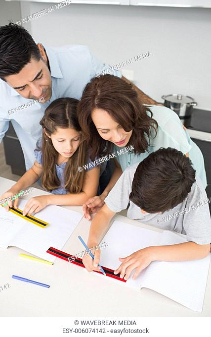 Couple helping kids with their homework