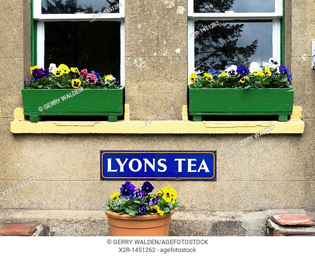 Lyons Tea advertisment below window boxes on Alresford station which is part of the Mid Hants  Railway in Hampshire, England