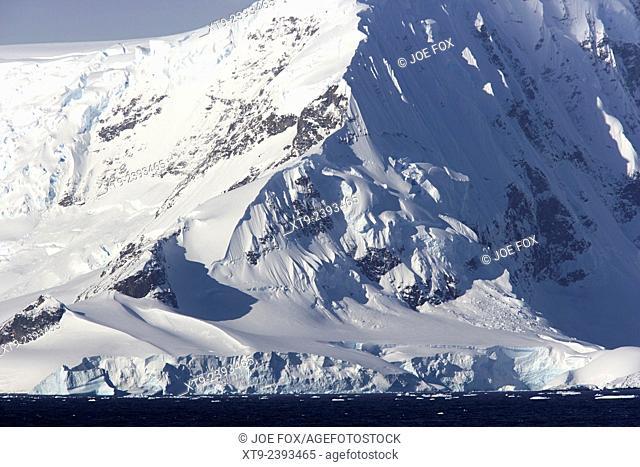 mist covered mountain ridge arctowski peninsula Antarctica