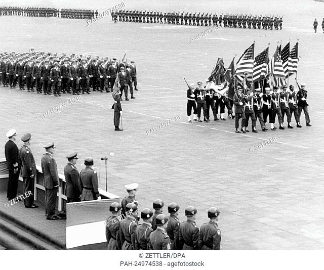 Soldiers of the US Army marching past a VIP stand at airport Tempelhof in Berlin on occasion of a parade for the 'Armed Forces Day' on 20th May 1961