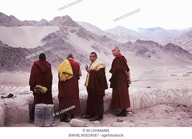 monks on the roof of Spituk monastery, India, Ladakh
