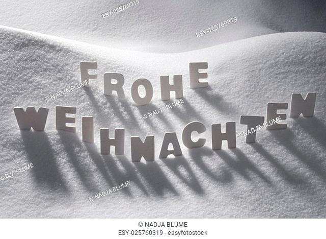 White Wooden Letters Building GermanText Frohe Weihnachten Means Merry Christmas. Snow And Snowy Scenery. Christmas Atmosphere