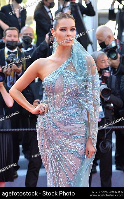 """09 July 2021, France, Cannes: Model Maeva Coucke attends the screening of the film """"""""Benedetta"""""""" during the 74th Annual Cannes Film Festival at Palais des..."""