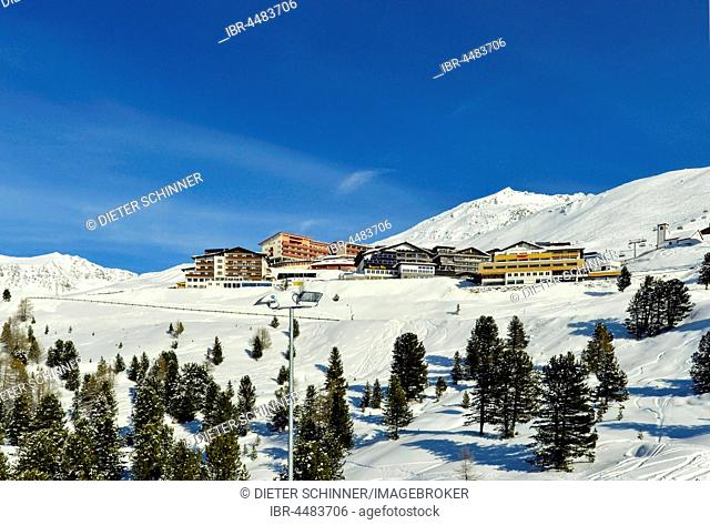 Hotels and Church, Winter, Hochgurgl in Oetztal, Oetztal Alps, Tyrol, Austria