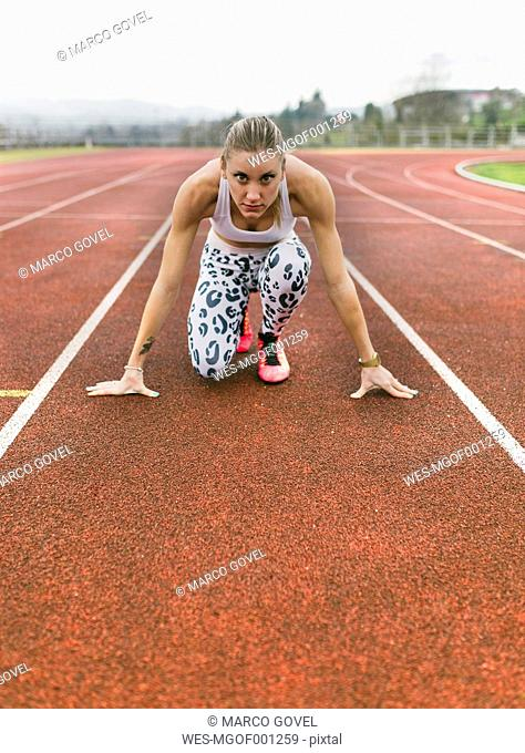 Athlete woman on a running track