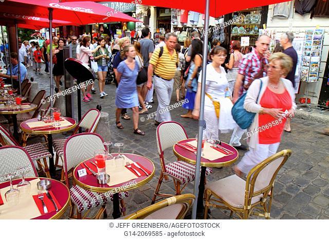 France, Europe, French, Paris, 18th arrondissement, Montmatre, Place du Tertre, restaurant, cafe, brasserie, tables, chairs, pedestrians, alfresco,