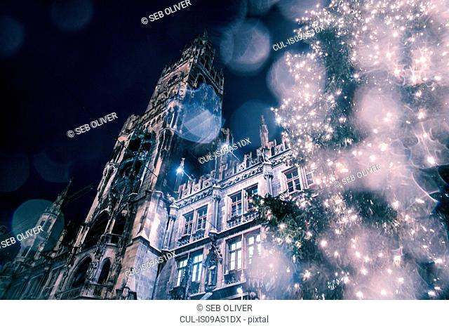 Low angle view of The New Rathaus (Town Hall) and Christmas tree at night, Munich, Germany