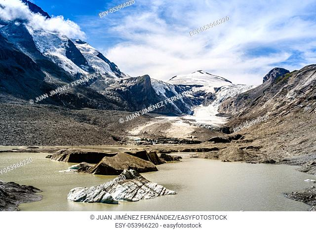 Scenic view of Grossglockner glacier by lake against sky