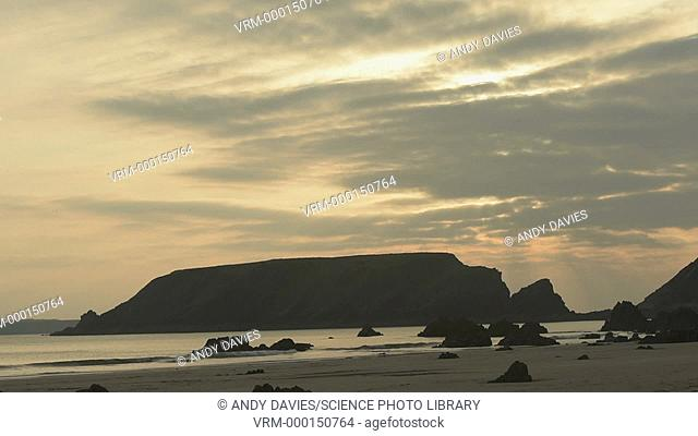 Rocky coastline at sunset. Filmed in Marloes Sands, Wales, UK
