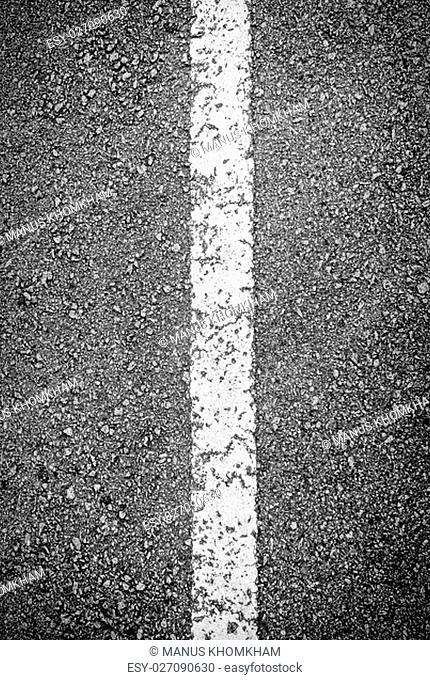 Texture of white line on black asphalt road