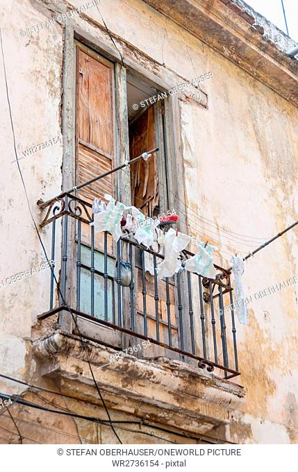 Cuba, Havana, Freshly washed disposable diapers on the clothesline on a balcony in the streets of Havana