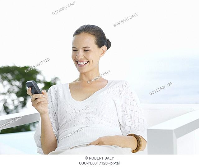 Woman with PDA outdoors smiling