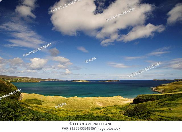View of coastline towards small islands, Rabbit Islands, Tongue Bay, viewed from Coldbackie, Sutherland, Highlands, Scotland, August