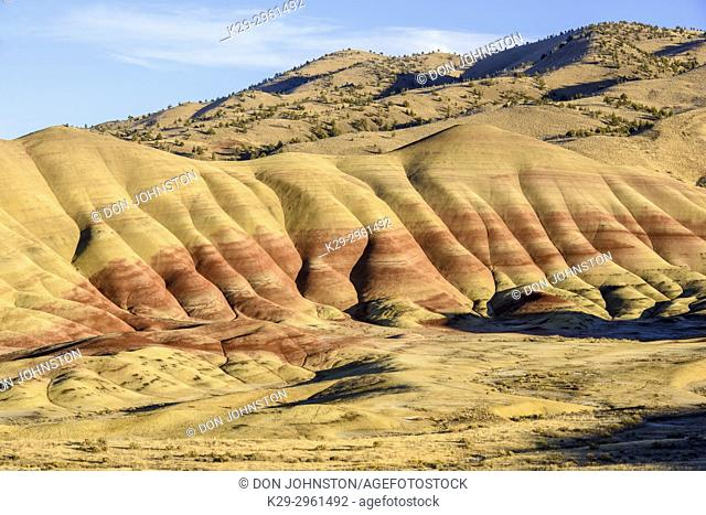 Eroded, exposed laterite and mudstone sediments in a sagebrush environment, John Day Fossil Beds National Monument, Painted Hills Unit, Mitchell, Oregon, USA