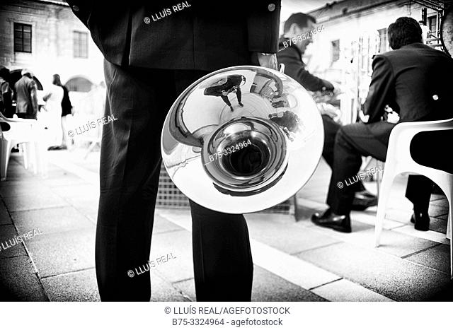 Back view of a man with a tuba in his hand (musical instrument) Mahon, Menorca, Baleares, Spain