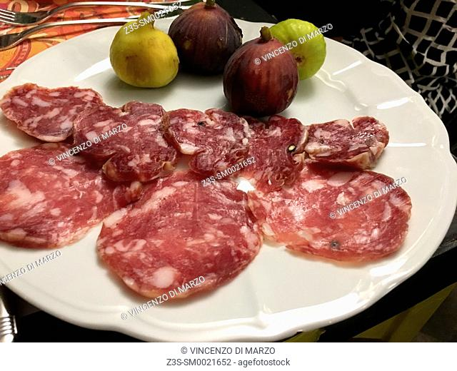 Salami nostrano and figs, typical mountain food