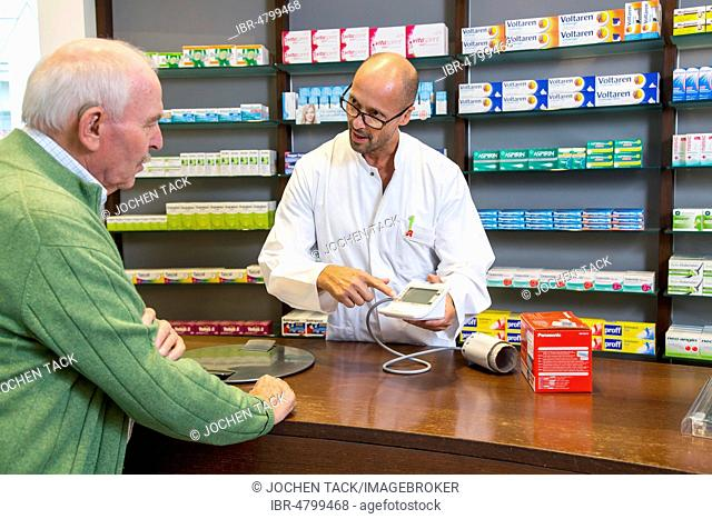 Pharmacy, Pharmacist advises a customer who wants to buy a blood pressure monitor, Germany