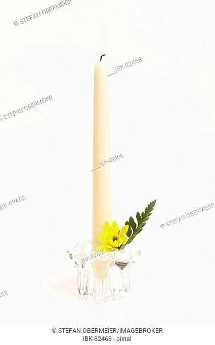 Candle with flower arrangement