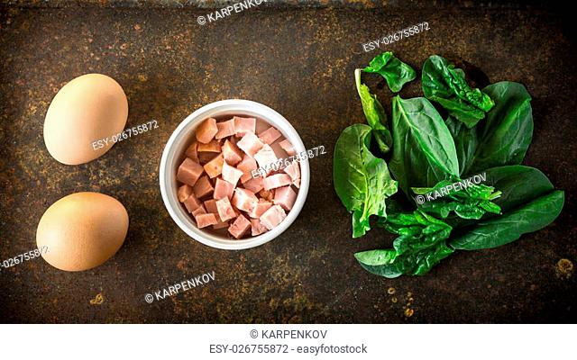 Ingredients for Florentine eggs with spinach on the rusty background