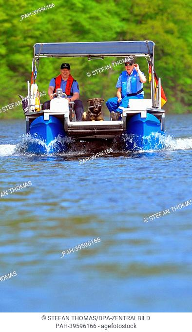 Canine officer Karlheinz Floeter (R) from the Suhl Police Department sail across the Hohenwarte Reservoir with sniffer dog Aik on a water police boat in...
