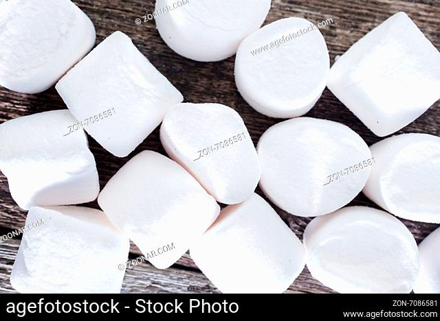 white marshmallows on the wooden table, fresh and sweet marshmallows