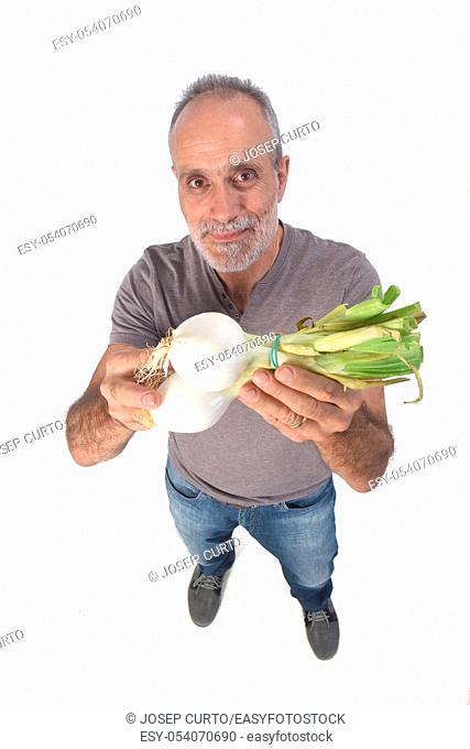 portrait of a man with onion on white background