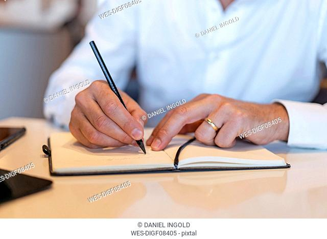 Close-up of businessman taking notes