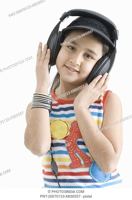 Portrait of a girl wearing headphones and listening to music