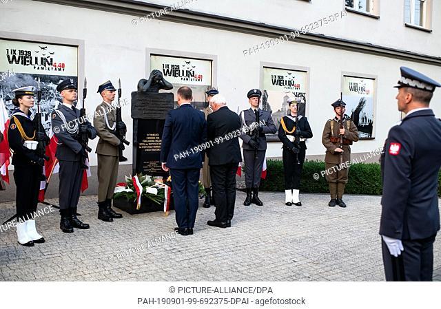 01 September 2019, Poland, Wielun: Federal President Frank-Walter Steinmeier and Polish President Andrzej Duda lay flower arrangements at the memorial ceremony...