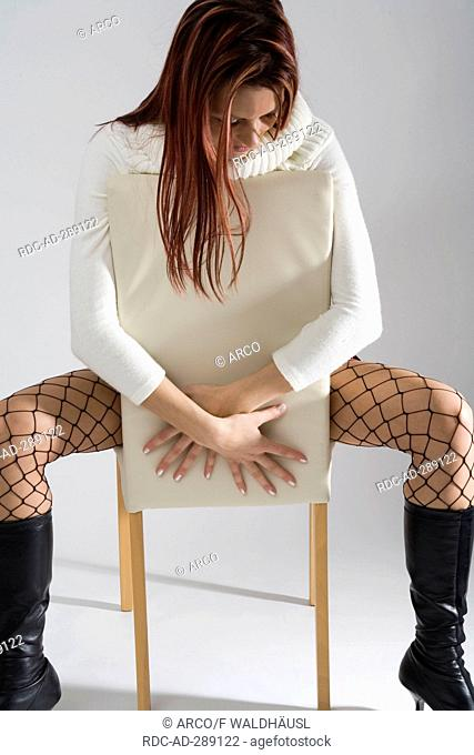 Young woman in black fish net stockings