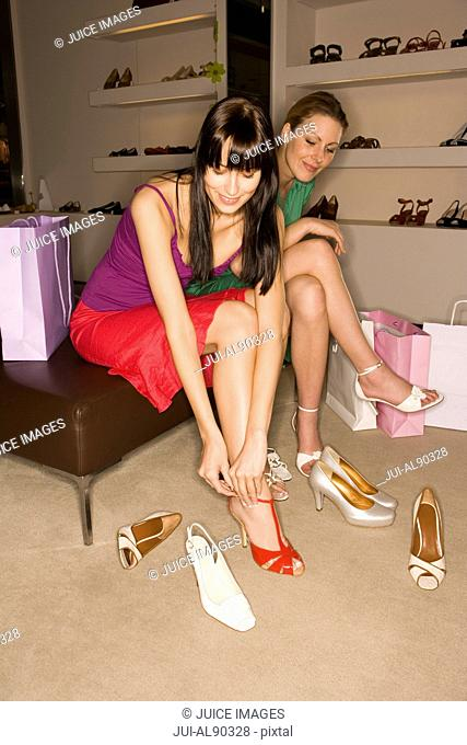 Two women trying on shoes