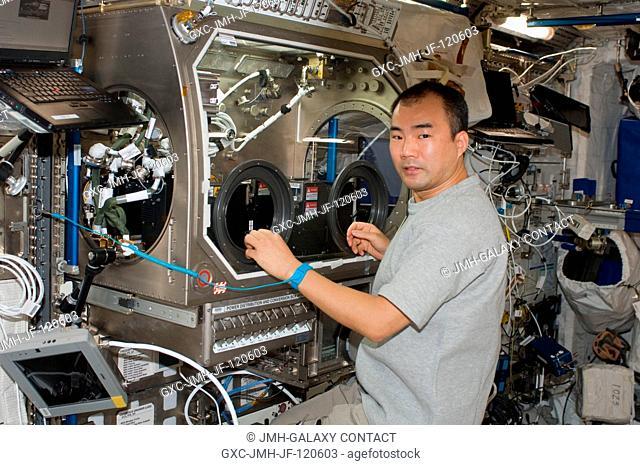 Japan Aerospace Exploration Agency (JAXA) astronaut Soichi Noguchi, Expedition 22 flight engineer, works with the European Space Agency (ESA) science payload...