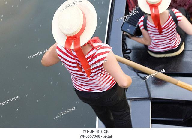 High angle view of a gondolier paddling gondola